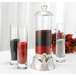 Hearts Sand Ceremony Kit$55.00 Set of four includes large cylinder with glazed resin base and removable lid carved with hearts featuring rhinestone accents and three smaller cylinders.