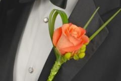 boutonniere orange with beargrass