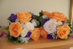 Lindas wedding orange roses purple touch