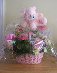 Baby basket flower arrangements by Le Bouquet Blanc